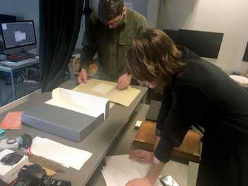 Editor and photographer look at Emily Dickinson archival materials